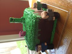 My son minecraft cake. A block of dirt with homemade creeper, steve, pig, notch and Herobrine.