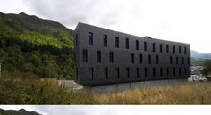 zon-e Architects has designed a dynamic building that houses 15 apartments, and hasn't sacrificed style in the process.