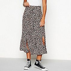 Freshen up your wardrobe with this leopard printed midi skirt from Red Herring. Perfect for an evening look or easy everyday style, it features front split details and a bold print. Team with a leather jacket and trainers for a fierce look. Leopard Print Skirt, Red Herring, Brown Leopard, Maternity Wear, Everyday Fashion, Midi Skirt, Leather Jacket, Clothes For Women, My Style
