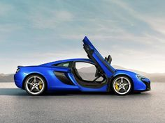 Both a coupe and a convertible version of the 650S will be available, same as with the MP4-12C (often called the 12C for short). The 650S coupe will feature McLaren's signature swing-up doors, while the convertible, called the 650S Spider, will include the ingenious folding hard top from the 12C Spider.