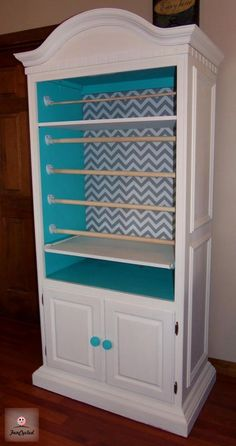 """Gift wrapping station for the """"crafty"""" room - using an old armoire"""