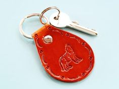 Click To Shop Now – Handmade Leather Keyring, Leather Keychain, Why not check out my Etsy shop? #wolf #keyring #leather #keychain #animal #handstamped #birthdaygift #christmasgift Leather Bookmark, Leather Keyring, Leather Gifts, Leather Tooling, Handmade Leather, Classic Leather, Gifts For Husband, Boyfriend Gifts, Hand Stamped