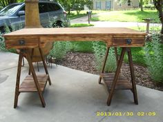 rustic pine desk with saw horse legs.