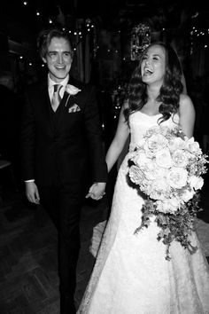 Omg her dress is so pretty and they are just the cutest couple alive :)