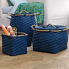 Rope Bin Collection - Cobalt  Woven by hand of squared-off rattan with a thick jute rope wrapped around the top, these rugged bins are easy to tote from playroom to bedroom to laundry room.