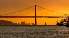 Sunset behind 25th of April Bridge - Lisbon, Portugal