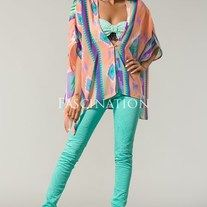 Fashionable aztec print poncho. Low V-neck cut top with a sheer effect. Asymmetrical layering and a unique pattern detailing the shirt.  100% Polyester  Made in USA