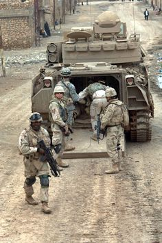 Soldiers from the 3rd Armored Cavalry Regiment load into an M2 Bradley infantry fighting vehicle as they conduct a combat patrol in the streets of Tall Afar Iraq on Feb. 6 2006 [16602500]