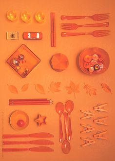 Collection of orange objects on orange background... by CatMacBride | Stocksy United