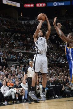 Kawhi Leonard #2 of the San Antonio Spurs shoots a jumper against the Golden State Warriors in Game One of the Western Conference Semifinals during the 2013 NBA Playoffs on May 6, 2013 at the AT Center in San Antonio, Texas.