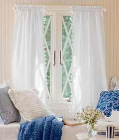 So many of you have written us about how long you've had your ball fringe curtains. They're wonderful, wonderful!  (Country Curtains Classic Ball Fringe Perma-Press Cafe Curtains. Available in White and Natural.)