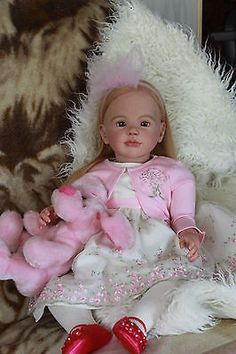 Reborn doll Nora /kit Sally by Regina Swialkowski. Reborn Toddler Girl, Baby Girl Dolls, Reborn Baby Dolls, Brown Curly Hair, Tan Skin, Toddler Shoes, Beautiful Dolls, Sally, Doll Clothes