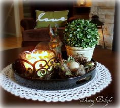 Easter Decor on Coffee Table by dining delight, via Flickr  love the pillow in the bacground