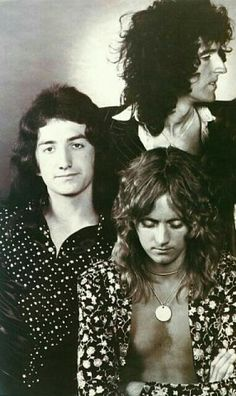 John Deacon, Brian May, and Roger Taylor of Queen.