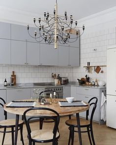 "FLOS North America on Instagram: ""Contemporary kitchen necessities. ⠀ 💡: 2097, Gino Sarfatti ⠀ 📷: @decoraid ⠀ ⠀"""