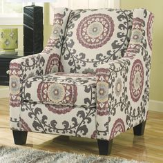Bohemian-style floral fabric with sloping track arms and a modern wing back. Our Price: $579.