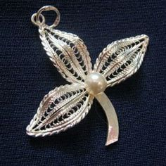 3 Leaves Filigree Hand Made Pendant - Sterling Silver & 5mm Swarovski Pearl compliments the craftsmanship of this beautiful pendant.  HAND MADE & CRAFTED in Malta. Includes a certificate issued by the Malta Crafts Council #   ... Size: 1.5 x 1.5 inches / 3.8 x 3.8 cms ... http://www.belovedtreasures.com.au/proddetail.asp?prod=tfm-pnd-00023