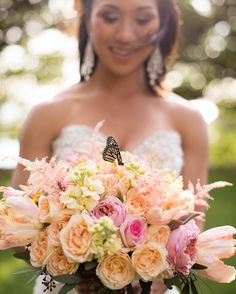 Butterfly, bride, and bouquet --- florals by Petals -- Kevin Lubera Photographer -- Bliss Maui Wedding at Kukahiko Estate