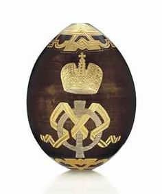A PORCELAIN EASTER EGG BY THE IMPERIAL PORCELAIN FACTORY, ST PETERSBURG, CIRCA 1880s Ovoid, the front and back of the brown glazed body painted and impressed with the gilt ciselé cypher of the Grand Duchess Maria Feodorovna beneath an Imperial crown, with geometric gilt ciselé apertures, unmarked.