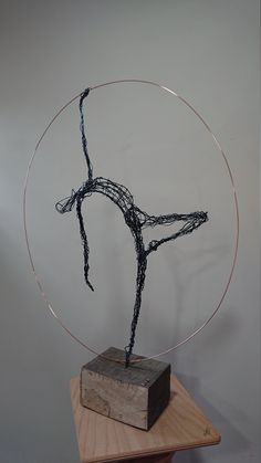 Wire sculpture of a dancer, within copper ring, mounted on a solid oak base. I create and sell bespoke wire sculptures of dancers and the human form. Each item is individually created from wire, mainly black coated aluminium or copper plated steel wire. Wire Art Sculpture, Sculpture Projects, Wire Sculptures, Sculpture Ideas, Abstract Sculpture, Bronze Sculpture, 3d Art Projects, Sculpture Garden, Sculptures Sur Fil