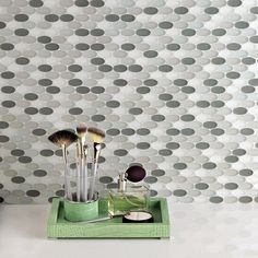 Artistic Tile |   Our glamorous Opera Glass Oval mosaic comes in both solids and blends.  Clean and modern, these glass mosaics are perfect for any space.