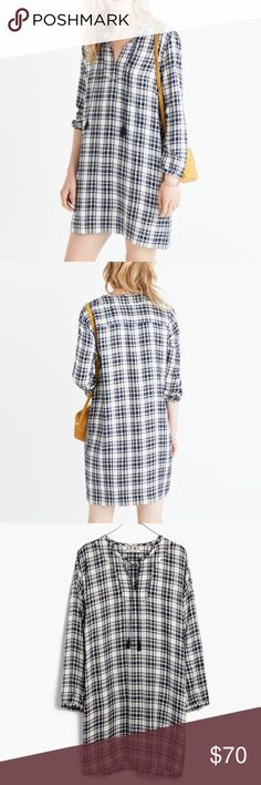 "Madewell Plaid Tunic Dress Madewell Plaid Tunic Dress. The easy every day dress. Layer with tights and boots or wear with sandals for summer. It's a year-rounder. Swingy tassels and side pockets. Pull on styling. Button detail on cuffs. 100% viscose. Length 35.5"". Underarm to underarm 21"". Madewell Dresses"