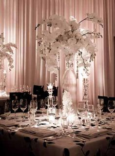 All white weddings are so gorgeous! Use uplighting to add color to the space.
