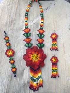 A personal favorite from my Etsy shop https://www.etsy.com/listing/271953364/mexican-huichol-beaded-flower-necklace