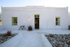 Akkedis Karoo cottage stay in Prince Albert - Eatsplorer White Wash Walls, Built In Braai, Canopy Bed Frame, How To Dress A Bed, Farm Cottage, Victorian Cottage, Farm Stay, Prince Albert, Flat Roof