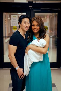 Black and asian. Ilia and Eugene leaving the hospital with their newborn