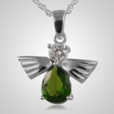 The Flying Angel Emerald Cremation Pendant is 14k white gold and crafted by an artistic skilled jeweler one at a time. The quality is excellent and the craftsmanship is outstanding. This Keepsake Pendant holds a small amount of remains, a piece of hair or something that is small enough to memorialize your loved one and bring them close to your heart.