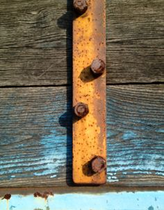 Rust and weathered painted wood.  Essex, CT