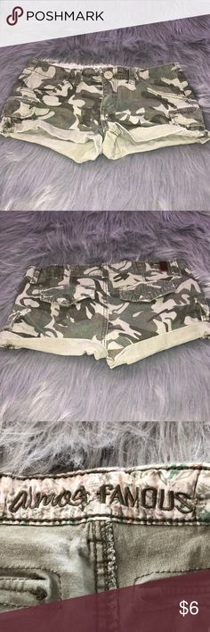 """Almost famous camo shorts size 5 Almost famous camo shorts size 5 juniors. All of my items come from a clean and smoke free home. Make me an offer 🙂.  Measurements taken flat: Waist 14 1/2"""" Inseam 3"""" Almost Famous Shorts"""