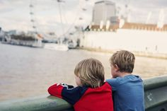 Two children on a bridge over the River Thames