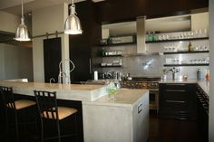 Love the modern kitchen with the barn lights wow