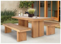 The KAYU collection from Design Within Reach. Made from slabs of unfinished teak DWR Table $1994.00 Bench $900 each