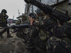 Philippine Soldiers and Marines clearing the streets of Marawi city of ISIS-linked militants from the Maute and Abu Sayyaf Salafi jihadist groups, on May 2017 in Marawi city, southern Philippines, during the Battle of Marawi. Philippine Army, Philippines, Special Forces, Marines, Battle, Soldiers, Street, Southern, Military