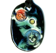 Planets in Space Ceramic Necklace in Black and Blue by surly, $18.00