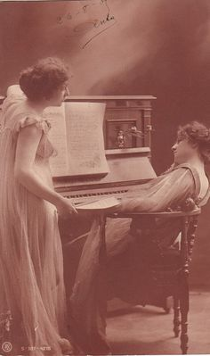 Vintage French romantic  post card. Romantic women with a piano.