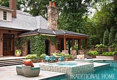A backyard swimming pool is just steps away from the screened porch. - Photo: Emily Jenkins Followill / Landscape design: Patrick Hand