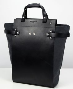 The 100% natural white cotton canvas tote with Black leather. The most knowledgeable costumer whose expert taste lies in exceptional materials and functionality will be delighted by it's vegetable tanning lined with suede.