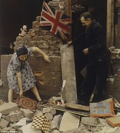 The British stiff upper lip: 'keep calm and carry on ... '   in the aftermath of a night of Luftwäffe Blitz-bombing raids, a British mother salvages her children's toys from the destruction of her house.