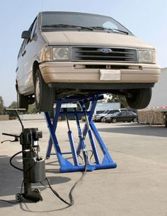"""6000 Lb. Capacity Scissor Lift Raise cars or trucks 56"""" to work on brakes, mufflers or wiring. Steel plate construction. Includes lift,"""