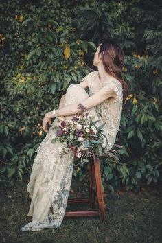 floral applique lace mesh wedding dress and wildflower bouquet