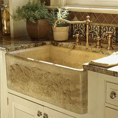 Beautiful travertine apron front sink. I need to phone one of our granite suppliers and see if they have this!