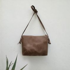 Minimal crossbody bag with hand waxed fabric, a travel purse with leather straps, a zipper handbag