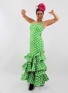 Trajes flamenca 2015 Azucena lycra en Oferta para Señora de tirantes de color verde pistacho con lunares blancos grandes, son trajes de gitana de talle bajo con tres volantes grandes, las mangas son de tirantes, muy cómodo y ligero de llevar. Puedes complentar tu traje de gitana comprando los complementos de flamenca que más abajo te ofrecemos. #trajesdeflamenca http://www.elrocio.es/trajes-de-gitana-talla-40/2252-trajes-flamenca-2015-verde.html