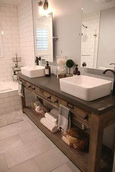 Bathroom Remodel: Restoration Hardware Hack - mercantile console table hacked into a double vanity. Vessel sinks & faucet from Lowe's. Tilt mirrors & edison sconces from Amazon. Copper baskets from Ho