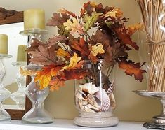Beach inspired Fall Leaf Decor. Add Fall leaves to your shell filled vase to capture the season: http://www.completely-coastal.com/2012/09/Fall-decorating-ideas-with-leaves.html