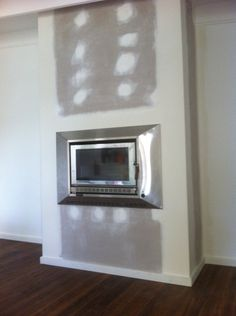 A Heat Charm wood fireplace in full stainless steel. Built into a combustible timber mock chimney. A zero clearance box was used. Five Star Fireplaces installed this.